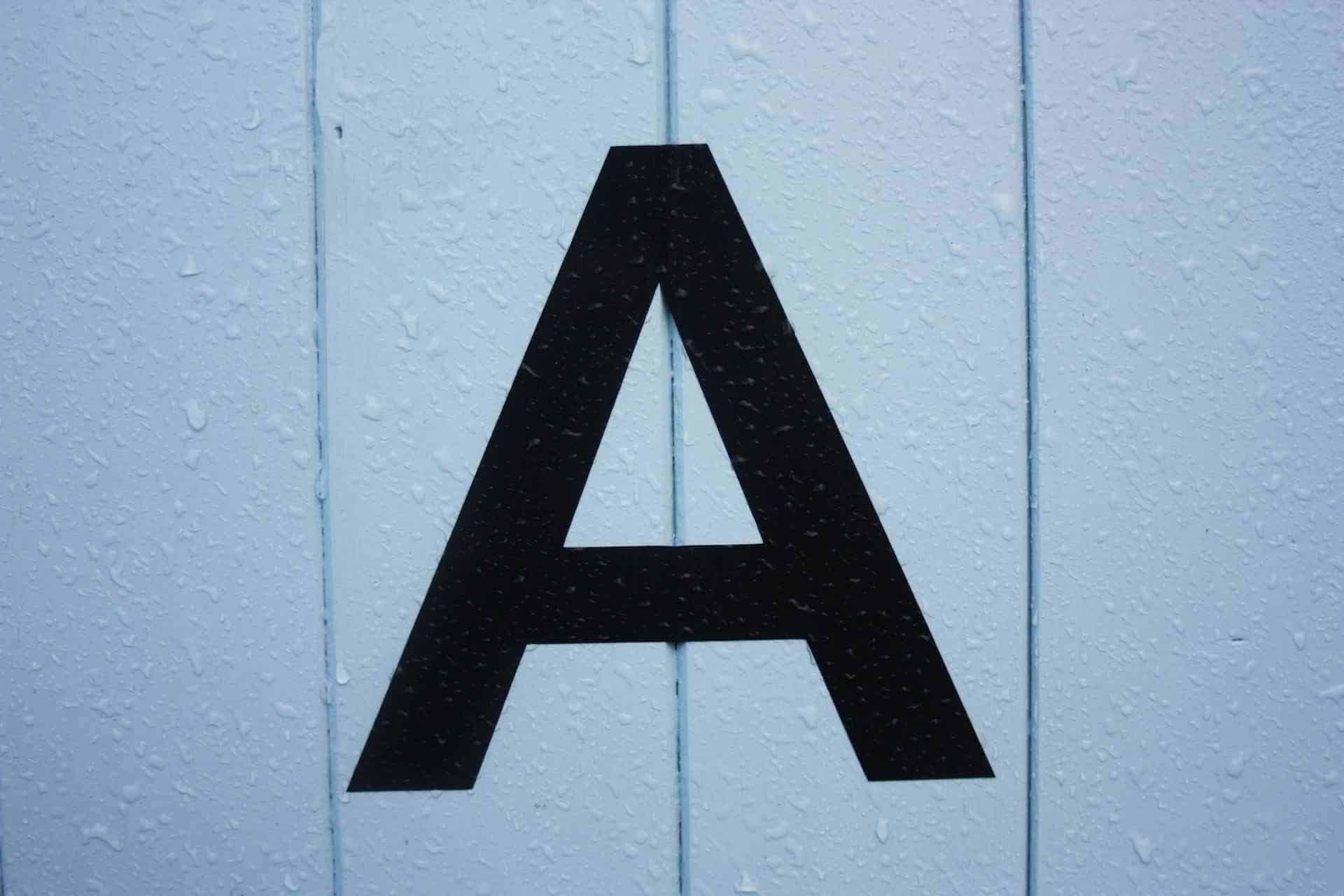 A wall with a letter A painted on it